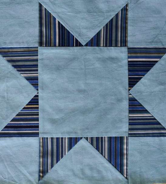 blue striped patchwork star on aqua background