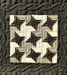 Quilted cable border around brown patchwork stars